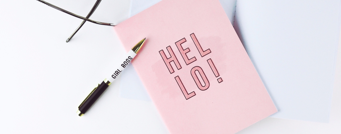 Pink card next to Girl Boss pen